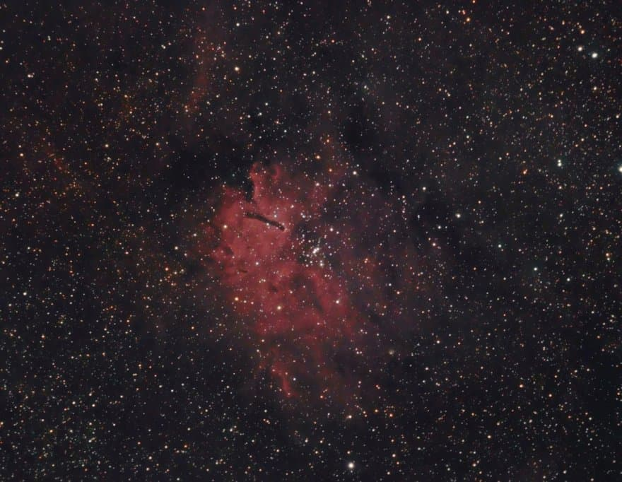 Open cluster NGC 6823 surrounded by the emission nebula NGC 6820.